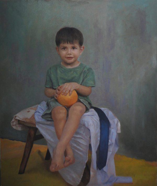 A boy with a grapefruit
